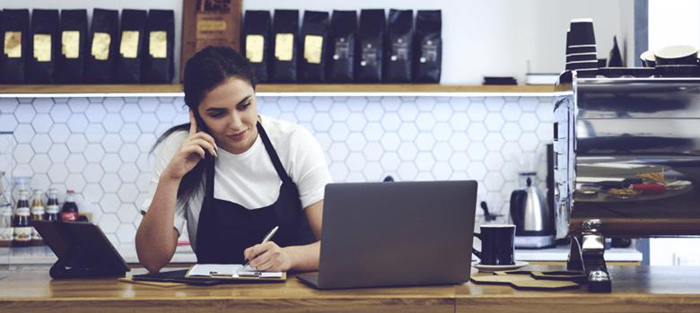 Cafe shop working using laptop