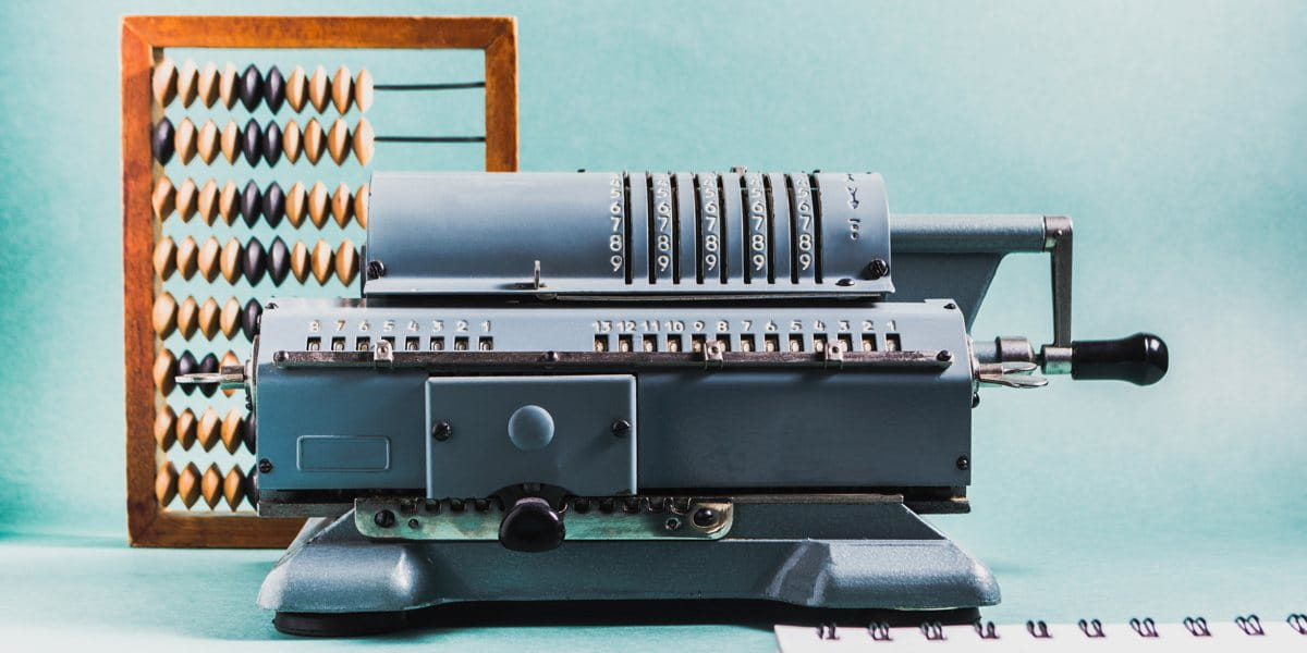 legacy IT systems, highlighted by old fashioned technology including an abacus