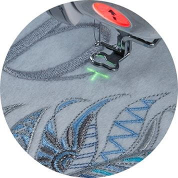 needle drop projected on embroidered fabric